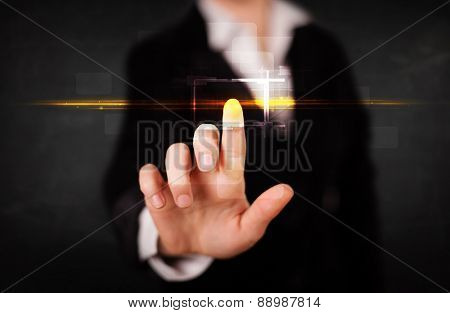 Tech woman touching button with orange light beams concept