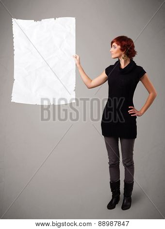 Beautiful young girl holding crumpled white paper copy space