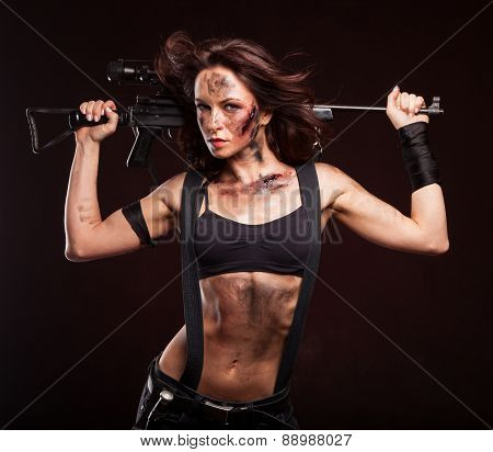 Sniper woman in leather sexy wear. Riot woman with gun