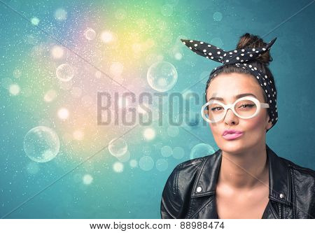 Young woman with sunglasses and bokeh colourful lights concept