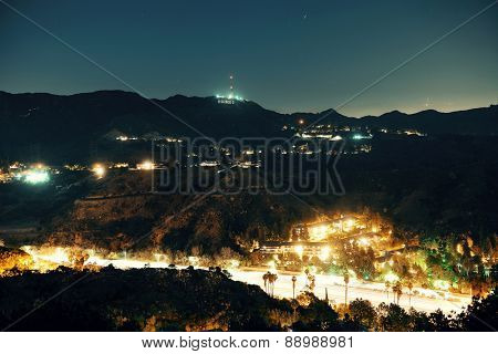 Los Angeles at night with Hollywood sign and highway