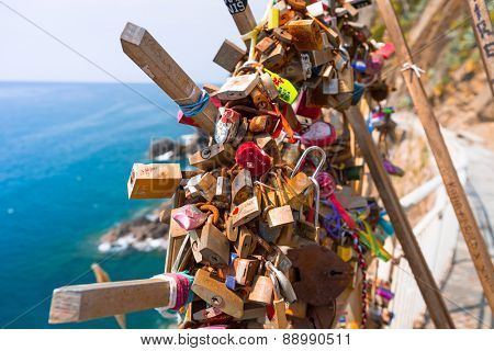 RIOMAGGIORE, ITALY - APRIL 12, 2015: Paddlocks for luck at the path of Cinque Terre in Riomaggiore, Italy. Cinque Terre National Park is popular tourist destonation with five coastline villages.
