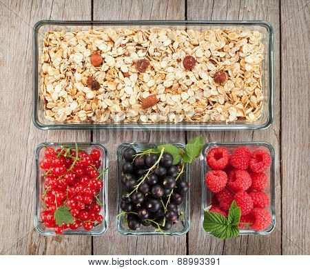 Healthy breakfast with muesli and berries. View from above on wooden table