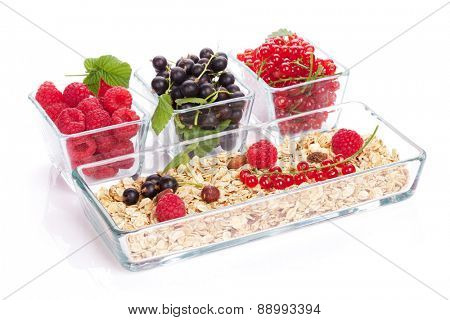 Healthy breakfast with muesli and berries. Isolated on white background