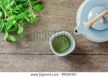Teapot And Cup Of Herbal Tea With Fresh Mint
