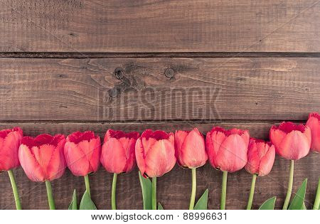 Bouquet Of Red Tulips On Wooden Background With Space For Message. Mother's Day And Spring Backgroun