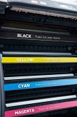 picture of dtp  - Close up of color laser printer toners cartridges - JPG