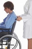 picture of rollator  - nurse is pushing her patient on a wheelchair - JPG
