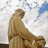 picture of blessed  - Statue of Jesus blessing a child in front of a church - JPG