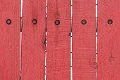picture of red siding  - Vibrant red antique wooden wall with screws background - JPG