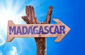 image of dauphin  - Madagascar wooden sign with sky background - JPG