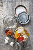 stock photo of pickled vegetables  - Home preserving mixed vegetables by pickling in glass canning jars - JPG