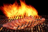 picture of bbq party  - BBQ Baby Back Spicy Marinated And Smoked Pork Ribs On The Hot Charcoal Grill With Bright Flames On Black Background - JPG
