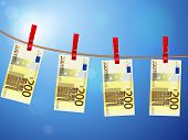 picture of clotheslines  - Euro banknotes hanging on a clothesline against a sky - JPG