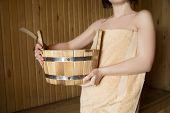 stock photo of sauna woman  - Beautiful woman in sauna bath accessories - JPG