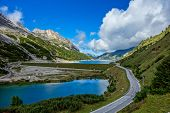 stock photo of lagos  - Lago di Fedaia in the Dolomites mountains of northern Italy - JPG
