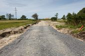 image of sand gravel  - A unfinished road construction with sand and gravel layers - JPG