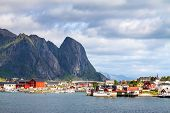 stock photo of fjord  - Scenic town of Reine by the fjord on Lofoten islands in Norway on sunny summer day - JPG
