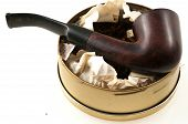 stock photo of tobacco-pipe  - pipe with round box of tobacco and accessories - JPG