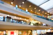 stock photo of department store  - Blur photograph of an indoor building of a grand department store with escalator between floors - JPG