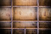 stock photo of divider  - A vintage wooden letterpress drawer with dividers.