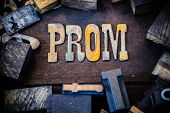 foto of senior prom  - The word PROM written in rusted metal letters surrounded by vintage wooden and metal letterpress type. ** Note: Visible grain at 100%, best at smaller sizes - JPG