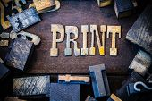 stock photo of lithographic  - The word PRINT written in rusted metal letters surrounded by vintage wooden and metal letterpress type.