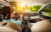 picture of car ride  - Woman rides on the car at high speed - JPG