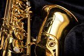 stock photo of sax  - Saxophone detail against the background of a velvet cover - JPG