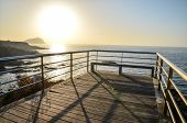 picture of canary  - Sunrise on a Pier over Atlantic Ocean in Tenerife Canary Islands Spain - JPG