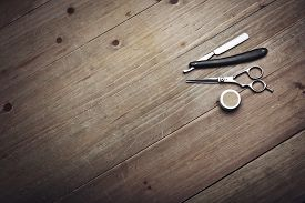 foto of barber razor  - Vintage Barber Equipment On Wood Background With Place For Text - JPG