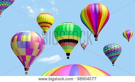 Several hot air balloon flying in the blue sky.