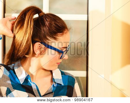Woman In Eyewear. Girl With Blue Eyeglasses
