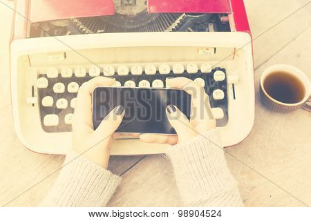 Girl With Cell Phone And Typewriter, Vintage Photo Effect