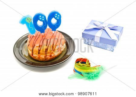 Donut With One Hundred Years Birthday Candle, Whistle And Gift On White