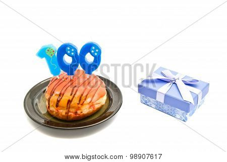 Donut With One Hundred Years Birthday Candle And Gift