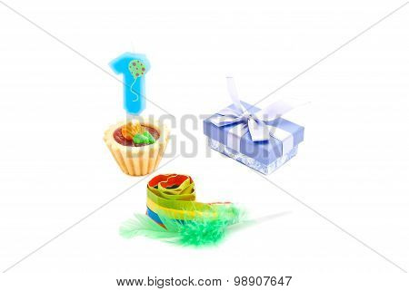 Cake With One Year Birthday Candle, Whistle And Gift On White