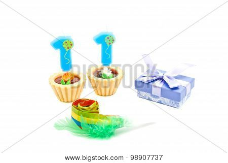 Cake With Eleven Years Birthday Candle, Whistle And Gift