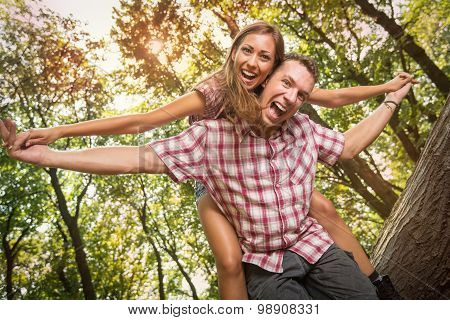 Cheerful Couple In The Forest