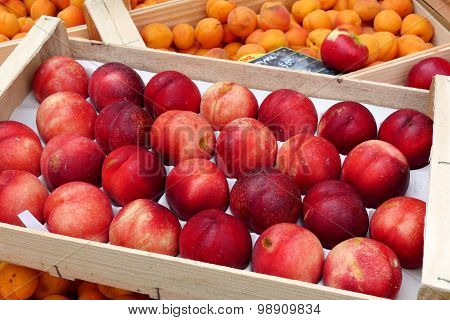 Display Of Peaches And Apricots In The Market