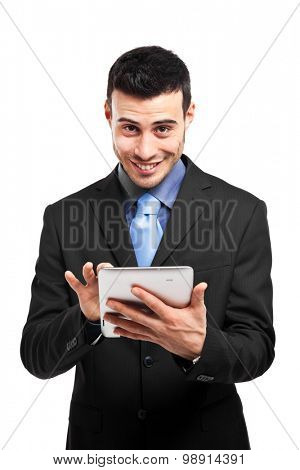 Smiling businessman using a tablet isolated on white