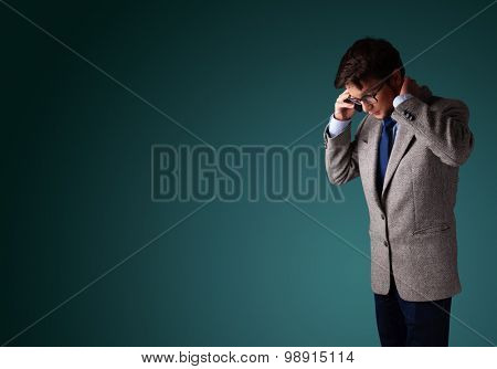 Young man standing and making phone call with copy space