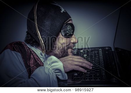 Illegal, computer security, hacker pirate dress with hat and skull