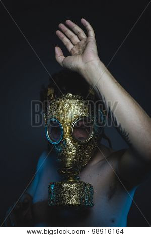 fear, depression and danger man with golden gas mask