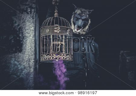 man dressed as werewolf cage and colored smoke