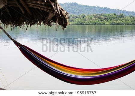 Colorful rainbow striped hammock on the beach