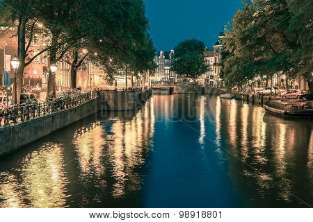 Night Amsterdam canal and bridge
