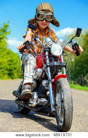 Handsome boy go on a journey on a motorcycle. Adventure. Summer holidays. Active lifestyle.