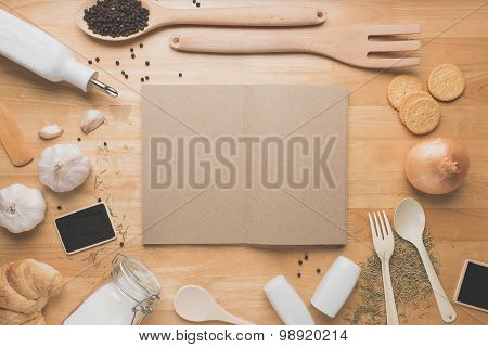 Top view kitchen mockup,Rural kitchen utensils, ingredients and book,notebook on wooden table