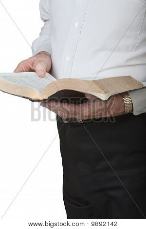 Man holding Bible.